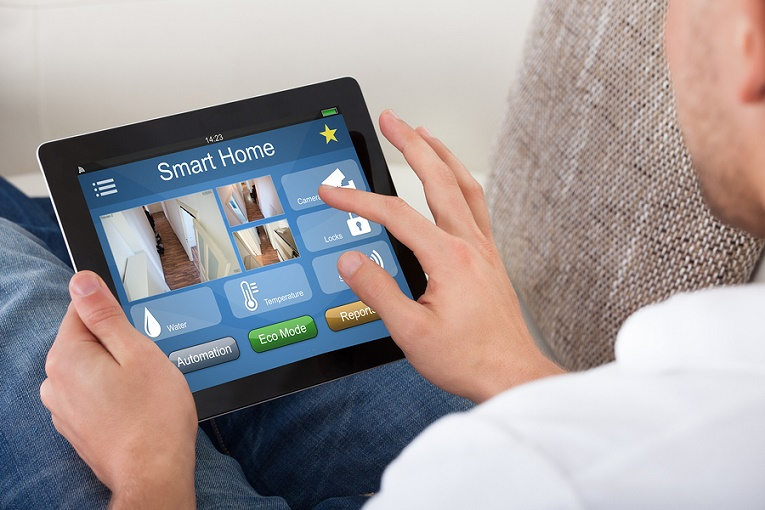 """man typing on ipad smart home"""