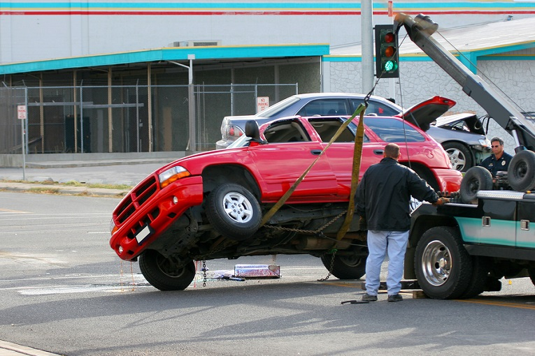 """red truck being towed"""