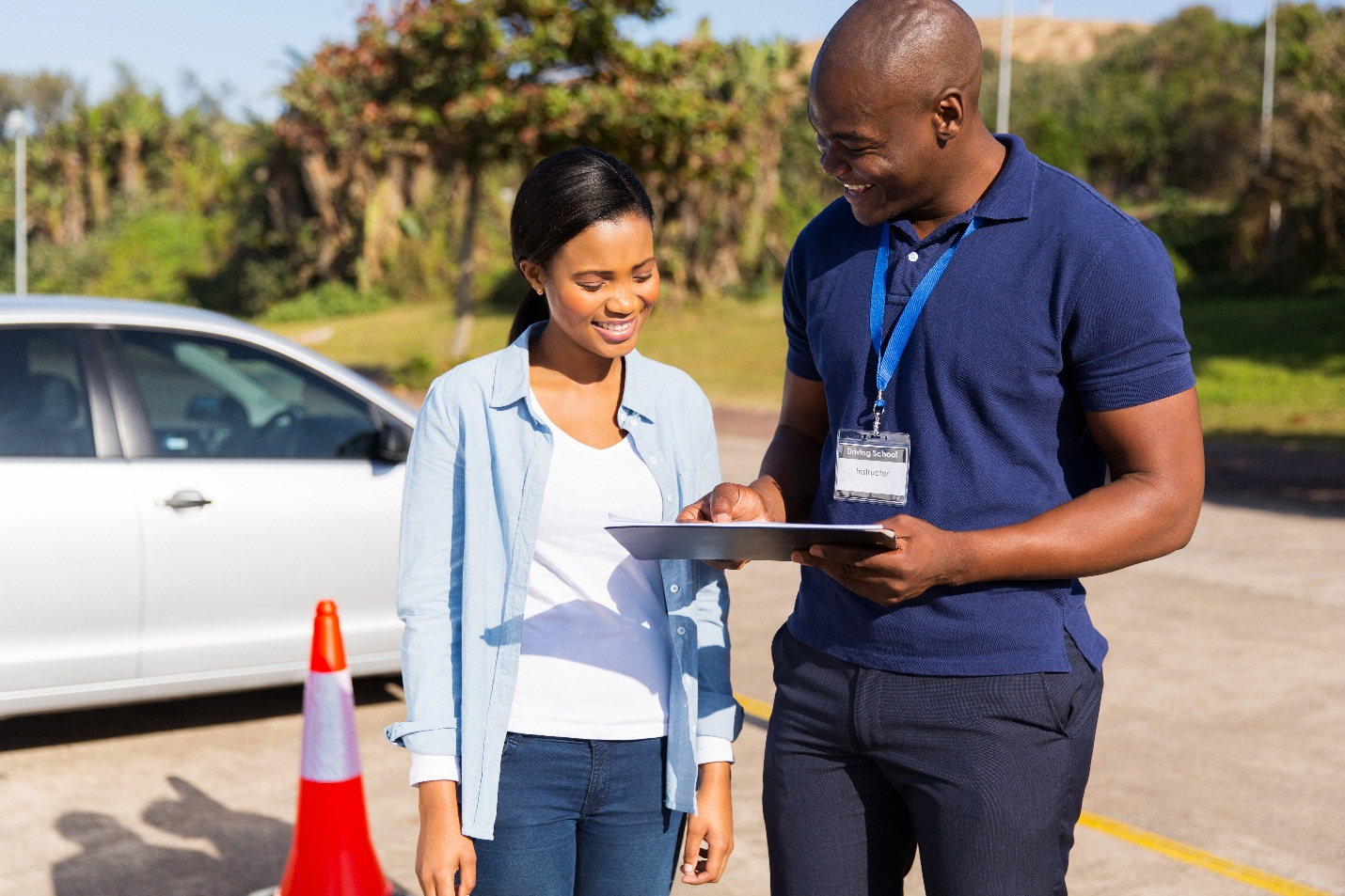 girl stands with driver take driving test