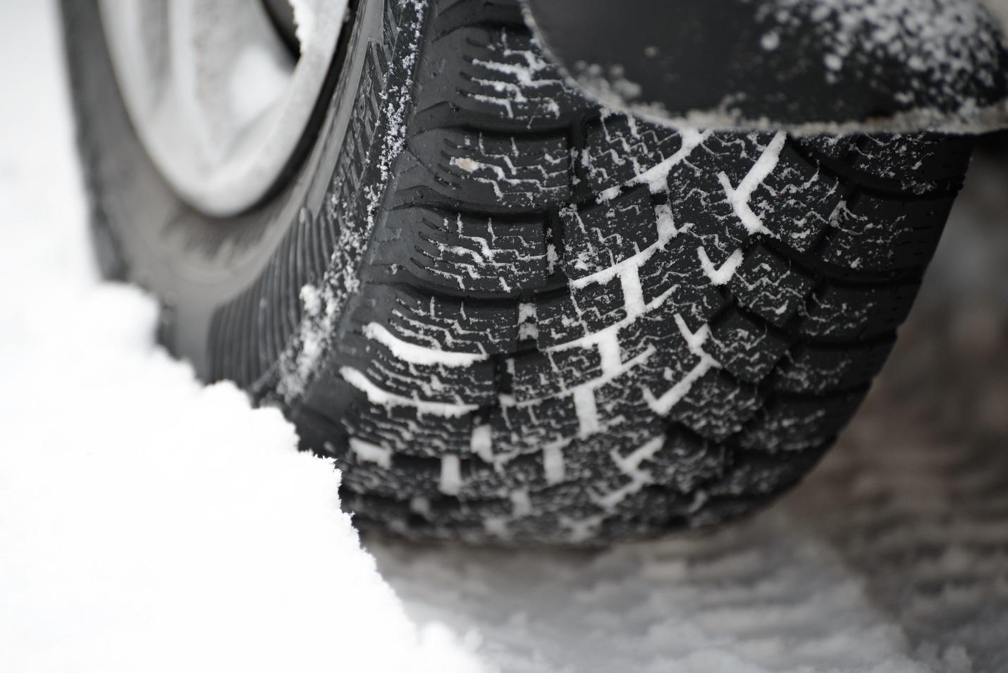 black winter tire in snow