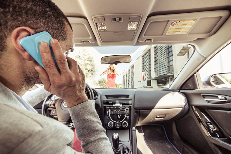 """man on phone in car"""