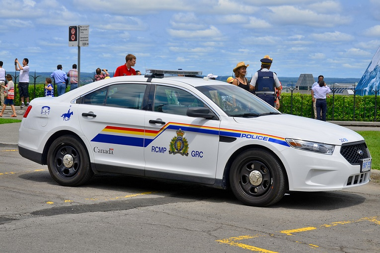 RCMP Police car in front of people Canada