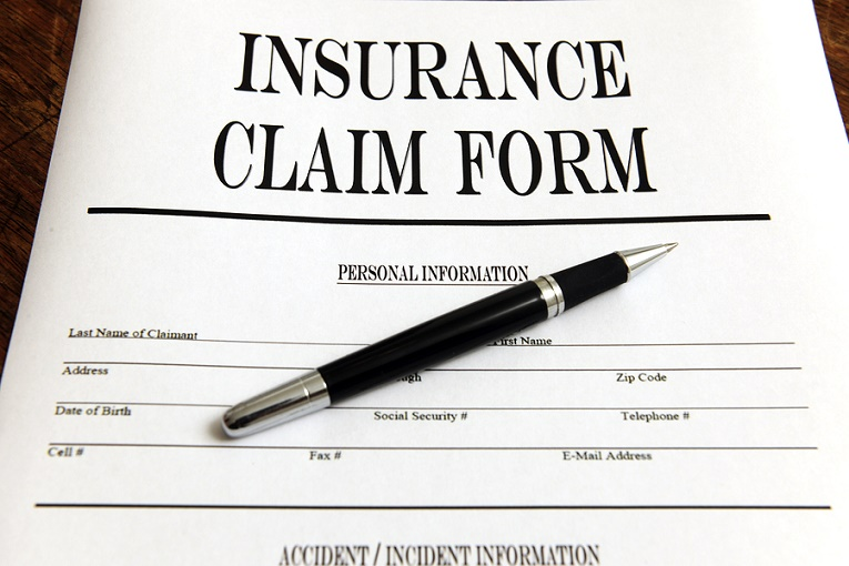 Pen on top of insurance claim form