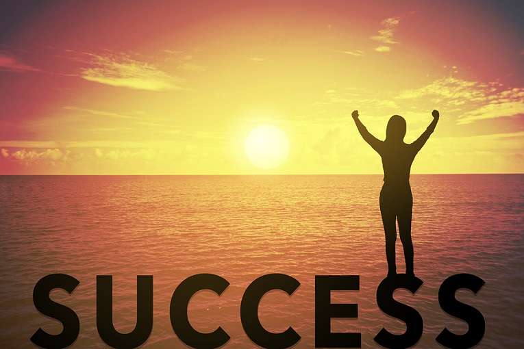 """""""woman with hands in air looking at sunset, success"""""""