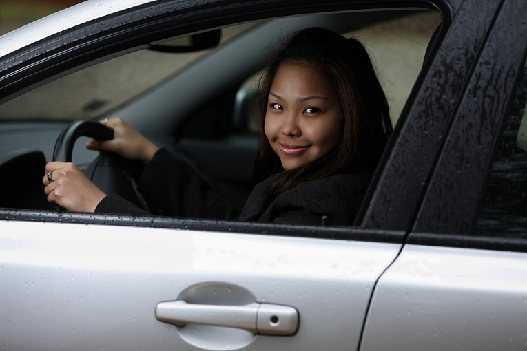 woman driving in car