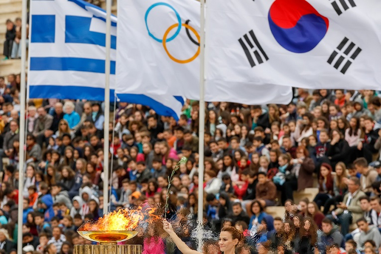 """woman at olympics holding flags"""