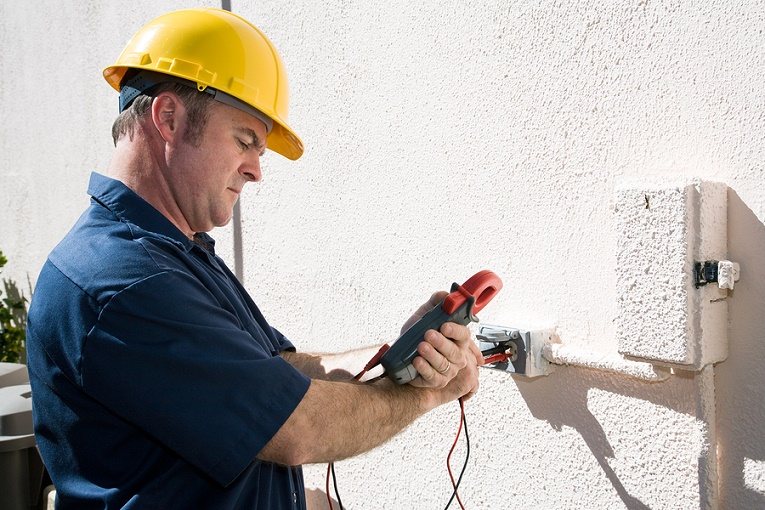 Electrician measuring voltage on home