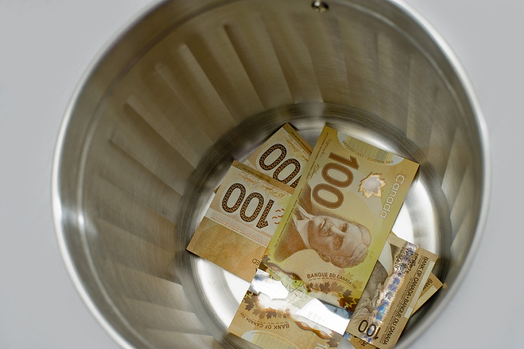 """100 dollar Canadian bills in tin"""