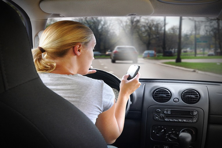 """""""woman texting while driving"""""""