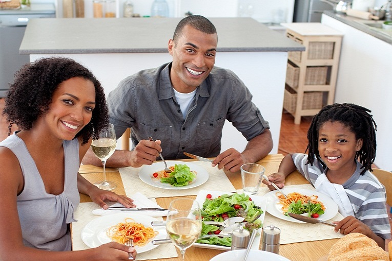 """""""family 2 parents eating with one child pasta and spaghetti with white wine."""