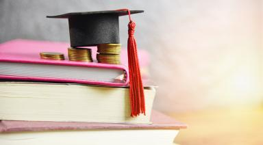 scholarship , graduation hat on top of books