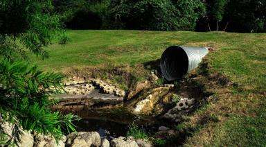 sewage pipe in the field