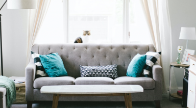 living room with grey sofa