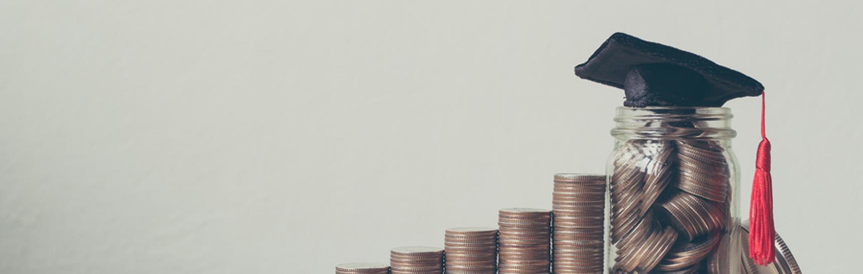 Scholarship money concept coins