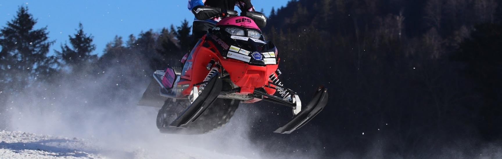man on a red snowmobile